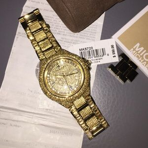 Authentic Michael Kors MK5720 paved in gold